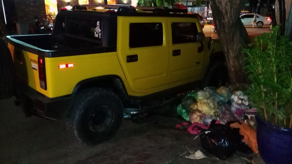 Hummer next to trash